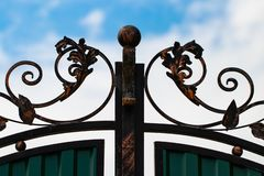Beautiful decorative metal elements forged wrought iron gates.  stock photography