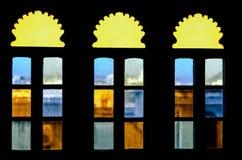 Beautiful decorative multi-colored windows in black. Background Stock Image