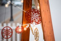 Beautiful decorative outdoor with Christmas ornamentation. Beautiful decorative outdoor with rustic Christmas ornamentation, with wood, lights and painted royalty free stock photography