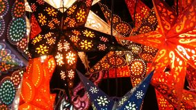 Beautiful decorative paper glowing Christmas stars lights on Christmas market in Germany. Beautiful decorative paper glowing Christmas stars lights on the stock video footage
