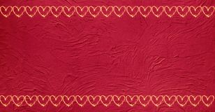 Vintage Grunge Red background with glowing hearts. Beautiful decorative Vintage Grunge Red background with two horizontal borders of glowing hearts. Holiday royalty free stock photos