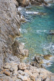 Beautiful Deep blue sea and rocks in Greece Stock Photos