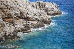 Beautiful Deep blue sea and rocks in Greece Stock Photography