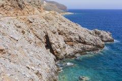 Beautiful Deep blue sea and rocks in Greece Stock Photo