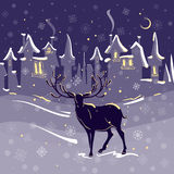 Beautiful deer christmas night snow town Royalty Free Stock Photos