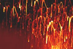 Beautiful defocused festive background in gold and red colors, like a sparks of fire Stock Photo