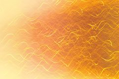 Beautiful defocused festive background in golden colors. Wallpaper, holiday design, blurred motion.  Stock Photography