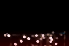 Beautiful defocused LED lights filtered bokeh abstract with marsala tone or red vine tone background. Royalty Free Stock Photos