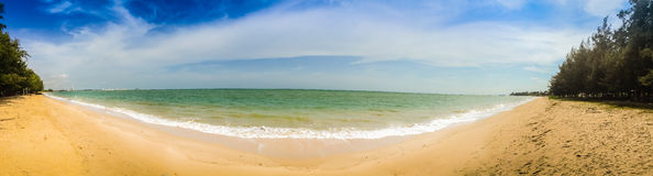 Beautiful 180 degree panorama view of white sand beach and blue Stock Photography