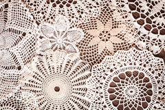 Beautiful delicate vintage lace background of crochet napkins on the table Royalty Free Stock Photo