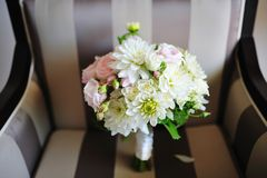 Beautiful delicate wedding bouquet on a chair Stock Images