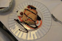 Delicious dessert of puff pastry on a white plate stock photography