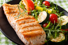 Beautiful and delicious food: grilled salmon fillets and vegetab Royalty Free Stock Images