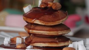 Beautiful delicious healthy Breakfast of pancake. Syrup pouring on the pancakes. Dessert of pancakes with syrup. Bright. Background stock footage