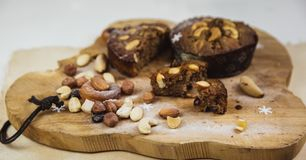 Beautiful delicious homemade Christmas dried fruit and nuts cake on wooden table royalty free stock images