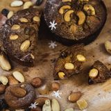 Beautiful delicious homemade Christmas dried fruit and nuts cake on wooden table royalty free stock photos