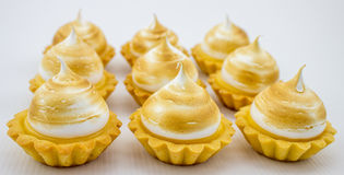 Beautiful and delicious petite lemon meringue tarts Stock Images