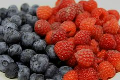 Rasberries and blueberries stock photos