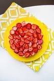 Beautiful and delicious strawberry cake stands on a yellow napkin Royalty Free Stock Images