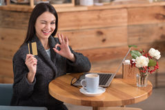Beautiful delighted woman presenting a discount card Stock Photos