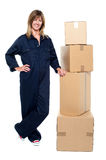 Beautiful delivery woman standing beside cartons Stock Photo