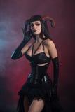 Beautiful demonic girl with horns wearing corset Royalty Free Stock Photo