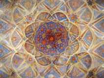 Beautiful dense ceiling decoration mosaics in Isfahan palace. Baroque and densely decorated ceiling of the Ali Qappu historical palace - now a museum - which royalty free stock photo