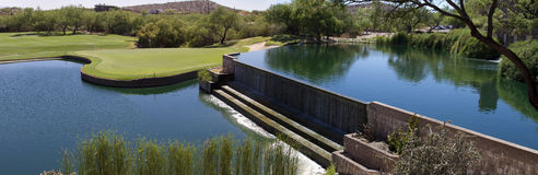 Beautiful desert golf course with lake waterfall