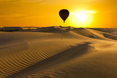 Beautiful desert landscape with a colorful sunset Stock Images