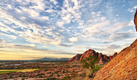 Beautiful desert landscape with red rock buttes. And gorgeous summer glowing sky wit little fluffy clouds located in Papago Park in Phoenix, AZ Royalty Free Stock Image