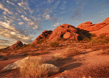 Beautiful desert landscape with red rock buttes. And gorgeous summer glowing sky wit little fluffy clouds located in Papago Park in Phoenix, AZ Stock Images