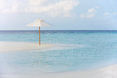 Beautiful Deserted Beach With Parasol. Beautiful Deserted Beach With Paraso Andd Blue Sky Royalty Free Stock Photos