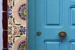 Traditional design doors in Chefchaouen. Beautiful design door frame and blue doors in Chafchaouen , Morroco Royalty Free Stock Photo