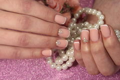 Beautiful design of manicure French with rhinestones royalty free stock photo