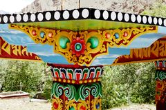 Beautiful design on the shed of prayer wheel outside Hemis Monastery Stock Photo