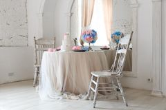 Beautiful design of the wedding table for the newlyweds. light luxury interior stock images