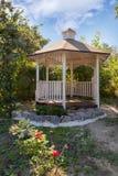 Beautiful designed white garden gazebo or pavilion in the backya royalty free stock photo