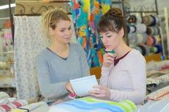 Beautiful designers working in dressmaking studio Royalty Free Stock Photo