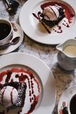 Coffee and dessert on marble table royalty free stock image