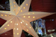 Beautiful detail in cut-out star ornament hanging in shop window Royalty Free Stock Images