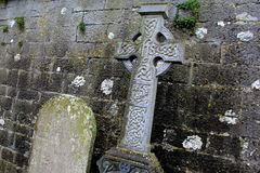 Beautiful detail in old Celtic cross and gravestone Royalty Free Stock Photography