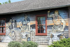 Beautiful detail in painting on side of building,depciting working men in Amish country,Intercourse,Pa,2013. Royalty Free Stock Photos