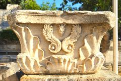 Ancient Greek column capital in ancient Agora of Athens, Greece royalty free stock image