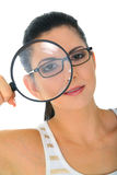 Beautiful Detective. Detective young woman looking through loupe royalty free stock photography