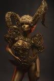 Beautiful devil women with golden ornamental horns Stock Photos