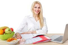 Dietician making a diet of fruits and vegetables. Beautiful dietician woman making a diet plan of fruits and vegetables for proper nutrition stock photos