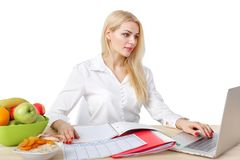 Dietician making a diet of fruits and vegetables. Beautiful dietician woman making a diet plan of fruits and vegetables for proper nutrition stock photography