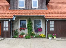 Colorful flowers near old home, Lithuania Royalty Free Stock Photo