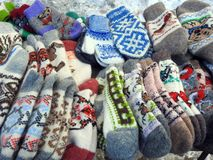 Socks and gloves for sale, Lithuania. Beautiful different colors socks and gloves for street sale stock images
