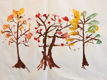 Colorful trees painted on white paper Royalty Free Stock Photography